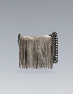 Fringed metallic bag, good for day or night.