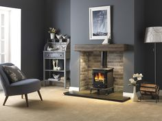 Renovate Your Old Fireplace With These Fireplace Makeover Ideas : A fireplace is something that makes the house look industrial and elegant and looks good. Revamp your old fireplace by these top Fireplace Makeover Ideas. Log Burner Living Room, Living Room With Fireplace, My Living Room, Home And Living, Wood Burner Fireplace, Old Fireplace, Fireplace Design, Fireplace Ideas, Inglenook Fireplace