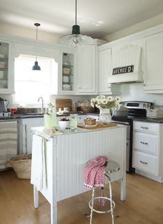 This kitchen is similar layout to mine... Now if can convince hubby to paint our wood cabinets white.