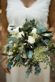 greenery wedding bridal bouquet with many tones of green eucalyptus succulents olives and some white floral roses Fall Wedding Bouquets, Wedding Flower Arrangements, Bride Bouquets, Flower Bouquet Wedding, Floral Wedding, Wedding Bride, Floral Arrangements, Bridal Bouquet White, Wedding Centerpieces