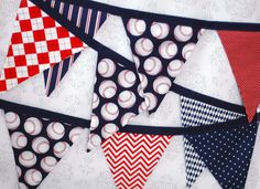 This would be cute with our color scheme.   BUNTING, Fabric Flag Banner, Pennant Nursery Decor, Photo Prop - Baseball in Red, Navy Blue and White  - 9 Feet 9 flags. $35.00, via Etsy.
