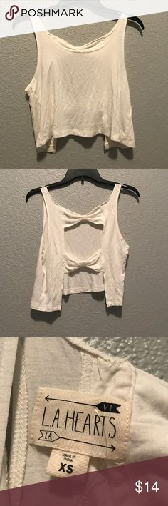 NWT Pacsun LA Hearts tank top NWT Pacsun LA Hearts tank top. Soft, white/off white, open back with two bows holding it together, cropped size xs PacSun Tops Crop Tops