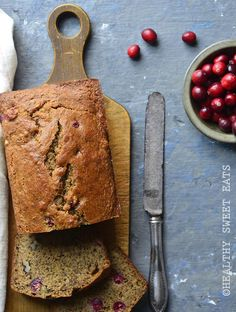 Paleo Cranberry Orange Walnut Bread is aromatic with orange and warm spices, and subtly sweet thanks to coconut sugar with a lovely contrasting sweet/tart flavor thanks to fresh cranberries. #recipe #baking