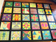 Students create a quilt using geometric shapes on a 20 x 20 grid.  They have to find the fractions and percents of the colors, plus area of the shapes {form on post}