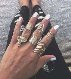 So many rings!  Stacking rings, midi rings, triangle rings, knuckle rings! #accessories