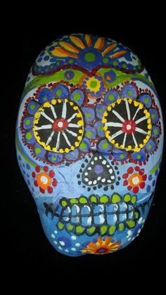 Hand painted river round rock 3 x2 Day of the dead skull Folk art style