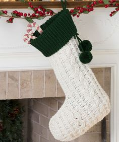 Crocheted Cable Christmas Stocking Elegant Aran stitches create this classic crocheted Christmas stocking design. Its generous size makes room for lots of treats!  free pdf from RH