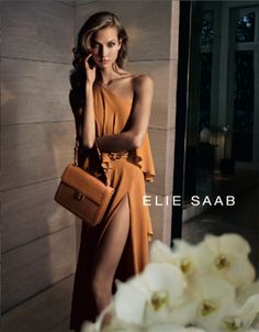 Golden Karlie – Karlie Kloss wows as the face of Elie Saab's spring 2012 campaign shot by Cédric Buchet. Wearing Saab's romantic designs styled by Sophia Neophitou-Apostolou, Karlie is an ethereal vision in a marigold gown for spring. Ellie Saab, I Love Fashion, Passion For Fashion, High Fashion, Fashion Beauty, Fashion Tape, Fashion Hub, Lifestyle Fashion, Fashion Story