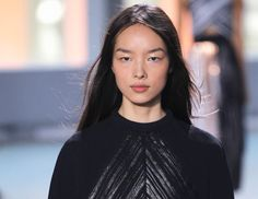 Flat Iron Only The Under Layers of Hair Hairstylist Paul Hanlon flat ironed hair around the ears and nape of the neck at Proenza Schouler in order to eliminate volume from naturally dried waves. #ghdSecrets