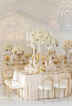 An all gold and white accent theme for chairs, linens, and table pieces