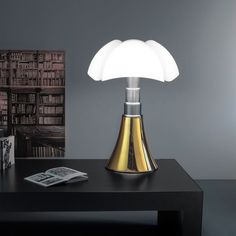Martinelli Luce in 10 frames: Pipistrello lamp, Gae Aulenti, 1965/2015