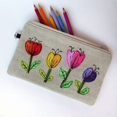 Small pouch handmade from linen and wool tweed decorated with freestyle machine embroidered flowers