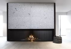 #Fireplace with Ceppo di Gre natural stone by De Puydt haarden.