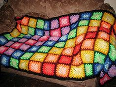 thedarkrose's Rainbow Granny Square Blanket. love the colors. great for a young child.