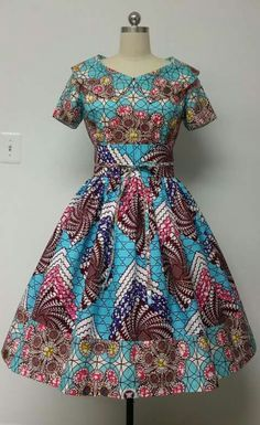 Mid-Low back. This is a fully lined multi fabric fitted waistline dress with rolled collar, Obi sash, and attached petticoat. Latest African Fashion Dresses, African Inspired Fashion, African Dresses For Women, African Print Dresses, African Print Fashion, Africa Fashion, African Attire, African Wear, African Women
