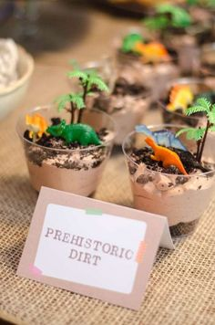 "Cool pudding ""dirt"" cups at a dinosaur birthday party! See more party planning ideas at CatchMyParty.com!"