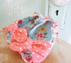 baby shoes. I can totally see little painted tootsies peaking out the ends of thes beautiful little shoes.