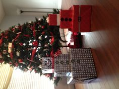 The boys gifts turned into Santa & snowman gift wrapped boxes. Look great next to the tree while we wait for Christmas morning. No names on boxes so who's is who's is still a Christmas surprise.