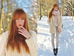 Marshmallow. Redheaded girl in sheepskin coat and snow