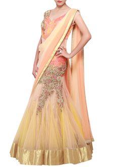 Featuring a net peach and cream shaded lehenga sari