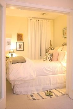 Cute small but cozy bedroom - idea incase 2nd / guest bedroom is small. Low lighting and splash of pink to create warmth.