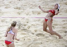 United States' Kerri Walsh Jennings, left, and Misty May-Treanor, celebrate after defeating April Ross and Jennifer Kessy in a women's gold medal beach volleyball match at the 2012 Summer Olympics, London, Wednesday, Aug. 8, 2012
