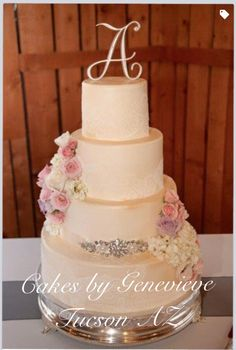 Elegant wedding cake with Flowers and lace details with cake sash. (I wish I could credit the photographer, but I can not remember her name)