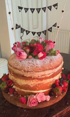 Naked hand decorated Victoria sponge cake