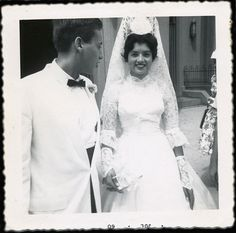1960 bride in a mantilla veil with her groom