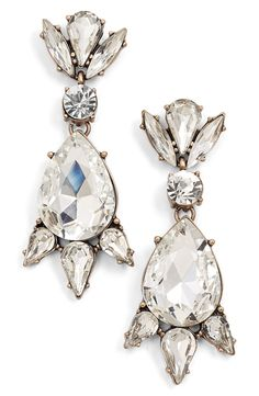 Diminutive crystals setaroundthesparkling central teardrop of these earrings willlend a retro elegance to anythingthey are paired with.