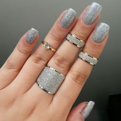 Allure ---Intense holographic micro glitter nail polish. Looks like tiny diamonds on the nail with an intense diamond affect.