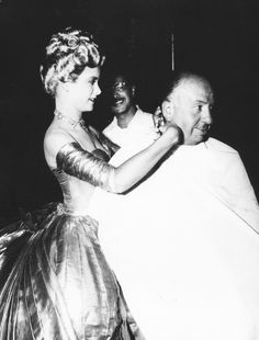 "Grace Kelly cutting Alfred Hitchcock's hair on the set of ""To Catch a Thief"" in Cannes, France, 1954"
