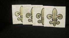$19.99 Hand painted fleur de lis coated coasters