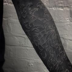 White ink on blacked out arm by @maxrathbone_tattooer #lovettt #tttism #blackout…