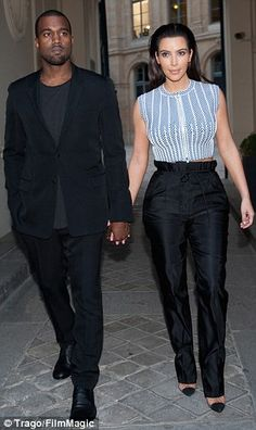 Kimye: Kanye West and Kim Kardashian have become a fashion power couple, seen here leaving the Louis Vuitton boutique opening on July 3, 2012 in Paris