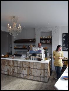 Don't like the white counter top - prefer all wood to that. But do love the rustic coffee bar and floor contrasted with the chandelier!