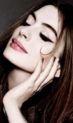 anne hathaway . Strong brows. Strong wing tip dark eyes. Soft natural pink lips