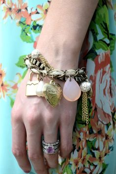 Blogger Lacy Rose sporting a Deb Shops charm bracelet.