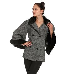 Featuring two button peacoat-like closure, faux fur lined collar and sleeves, and cape style fit. In classic black & white wool blend. Perfectly paired with a pair of skinny jeans & killer heels.