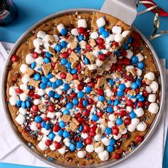 This red, white, and blue cookie pizza is so simple to make! This cookie cake comes together in under 25 minutes and is the perfect kid-friendly dessert recipe. Sweeten up your Fourth of July spread with this quick and easy dessert for a crowd. #redwhiteandblue #gourthofjuly #partyideas #food #cake #bhg Patriotic Pie Recipe, Patriotic Desserts, Blue Desserts, 4th Of July Desserts, Desserts For A Crowd, Easy Desserts, Dessert Recipes, Patriotic Party, Baking Recipes