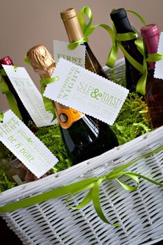 "Champagne basket with different ""reason to pop a bottle"" tags First Fight, First Baby.. Such a cute idea for newlyweds"