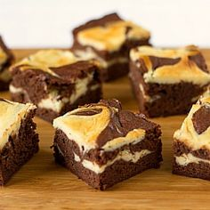 Cream Cheese Brownies - Fudgy brownies with two layers of cheesecake filling swirled throughout.