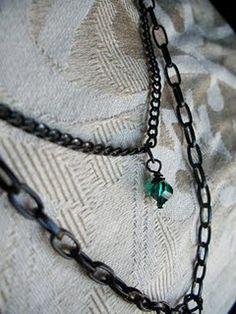 teal and black chain and glass. simple. love it!