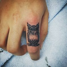 Nice And Simple Owl Tattoo On Finger