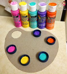DIY Paint Palette from Tutus and Tea Parties. I would glue the bottle caps on something washable like a heavy plastic plate.