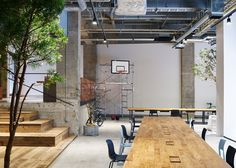 Concrete and scaffolding wood define areas at AKQA's offices