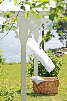 very nice trim on poles makes clothes line appealing in yard. Doing Laundry, Laundry Room, Laundry Art, What A Nice Day, Laundry Lines, White Cottage, Lake Cottage, Outdoor Living, Outdoor Decor