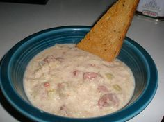 Reuben Chowder 3 cups milk   1 (10 1/2 ounce) can cream of celery   1/2 cup shredded swiss   1 (16 ounce) can sauerkraut drained 3 tablespoons soft butter   4 slices rye 1 t caraway 1-2 pkg buddig corned beef, chopped  In saucepan, stir milk in soup and cheese. Add sauerkraut cover and simmer 15 min spread the butter on rye sprinkle with caraway Cut into triangles; place on baking sheet.  Toast in 300 degree oven for 20 min.  Add corned beef to soup heat about 10 minutes Serve toast with…
