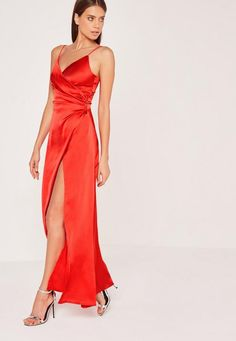 There's nothing sexier than a silky satin dress and this maxi will make you looked like you dropped some serious dollar. In a killer red hue, silky feel, cinched wrap over around, side split and maxi length, you'll be bringing the max facto...