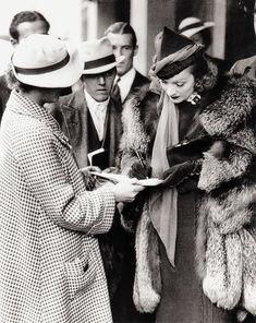 Marlene Dietrich signing autographs, 1936